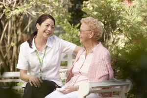 An in-home carer providing dementia care at home of an elderly client