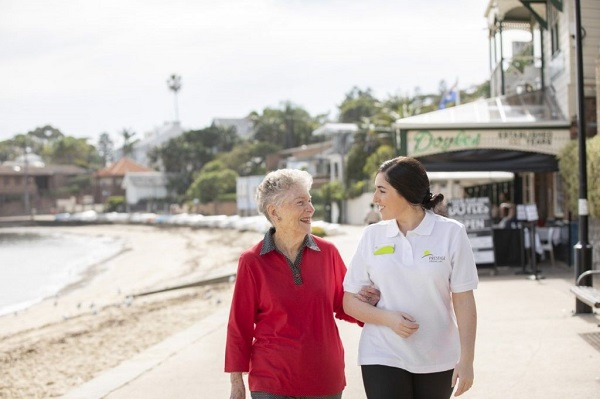 Prestige Inhome Care staff member walking with a client